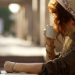 Stylish lady drinking coffee outdoors — Stock Photo #12258363