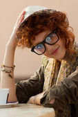 Hipster girl sitting in a cafe — Stock Photo