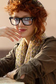 Hipster girl sitting at the table — Stock Photo
