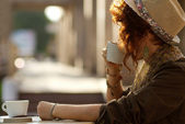 Stylish lady drinking coffee outdoors — Stock Photo