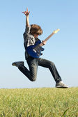Cool young guitarist jumping — Stock Photo