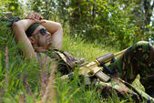 Soldier is taking a rest when the battle is over — Stock Photo