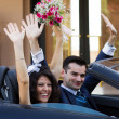 Happy newlyweds in cabrio — Stock Photo