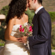 Young couple kissing after wedding — Stock Photo #13992367