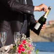 Waiter opens wedding champagne — Stock Photo #13992639
