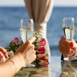 Couple raising wedding toast — Stock Photo