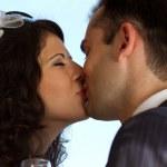 Sweet wedding kiss — Stock Photo