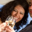 Young couple raising wedding toast — Stock Photo