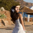 Happy young bride on the beach — Stock Photo