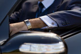 Hand of businessman in cabrio — Stock Photo