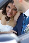 Happy newlyweds in cabrio — Stock Photo