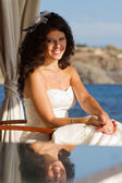Bride sitting at the table near water — Foto Stock
