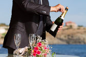 Waiter opens wedding champagne — Stock Photo