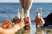 Couple raising wedding toast — Stock Photo