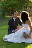 Young couple in the park after wedding — Stock Photo