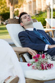 Young husband sitting with a happy smile — Stock Photo
