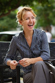 Businesswoman laughing at lunch — Stock Photo