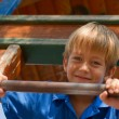 Happy young boy on the playground — Stock Photo