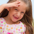 Funny toothless little girl outdoors — Stock Photo