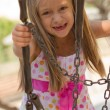 Funny toothless little girl on a playground — Stock Photo