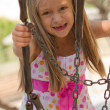 Stock Photo: Funny toothless little girl on a playground
