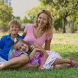Mom and her children in the park — Stock Photo