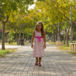 Funny little girl walking in the park — Stock Photo