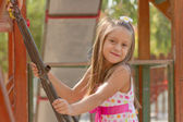 Funny little girl on a playground — Stock Photo