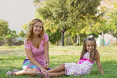 Mom and her daughter in the park — Stock Photo