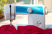 Sewing machine and silk cloth — Stock Photo