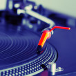 Turntable playing vinyl record - Photo