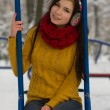 Cute girl on playground in winter - Foto Stock