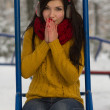 Cute girl on playground in winter - Stock Photo