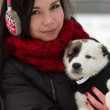 Girl with a puppy outdoors in winter — Stock Photo #18619925