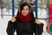 Cute girl on playground in winter — Stock Photo