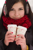 Cute girl in earplugs with coffee cup — ストック写真