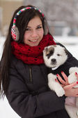 Girl with a puppy in winter — Stok fotoğraf