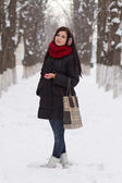 Girl walking outdoors in winter — Stok fotoğraf