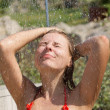 Royalty-Free Stock Photo: Sexy blond girl showering outdoors