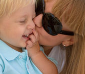 Mom kissing her little son — Stock Photo