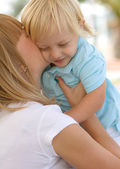 Mom and her cute little blond son — Stock Photo
