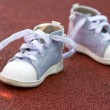 Royalty-Free Stock Photo: Little baby shoes on the ground