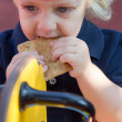 Cute blond boy with cookie — Stock Photo