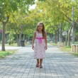 Funny little girl walking in the park — Stock Photo #24559229