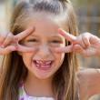 Funny little girl on the playground — Stock Photo #24559293