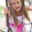 Funny toothless little girl on a playground — Stock Photo #24559303
