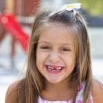 Little girl swinging in the park — Stock Photo #24559311