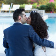 Young wife and husband kissing at the pool — Stock Photo #24559509