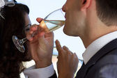 Young couple raising wedding toast — Foto de Stock