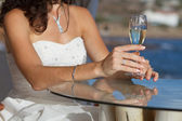 Bride holding wedding glass with wine — Stock Photo